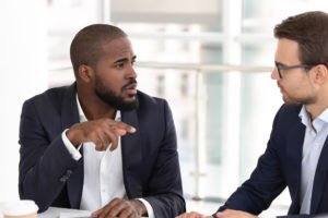 Two men having a difficult conversation at work